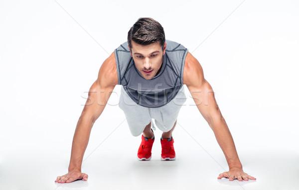 Fitness hombre flexiones aislado blanco deporte Foto stock © deandrobot