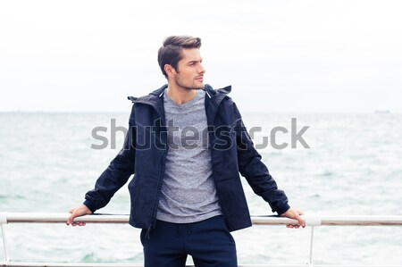 Portrait of a handsome man in sports wear Stock photo © deandrobot