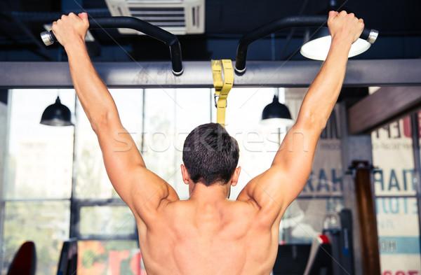 Adam yatay bar arkadan görünüm portre spor Stok fotoğraf © deandrobot