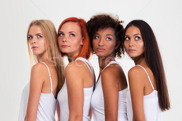 Peinzend vier meisjes portret geïsoleerd Stockfoto © deandrobot