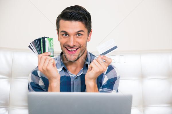 Vrolijk man creditcards portret home Stockfoto © deandrobot