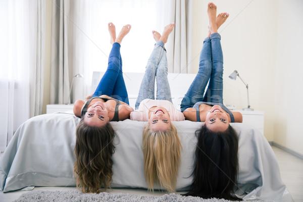 Glücklich Mädchen Bett angehoben Beine Porträt Stock foto © deandrobot