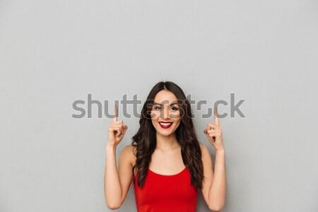 Asian girl having an idea Stock photo © deandrobot
