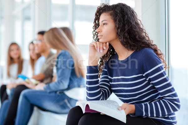 Afro american woman holding book Stock photo © deandrobot