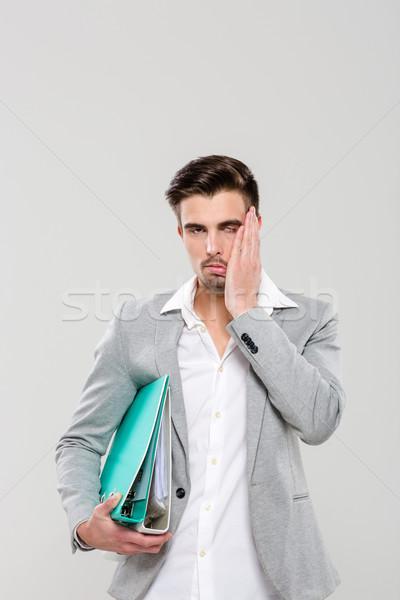 Bitkin genç adam işadamı yürütme Stok fotoğraf © deandrobot