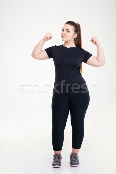 Happy fat woman showing her biceps  Stock photo © deandrobot