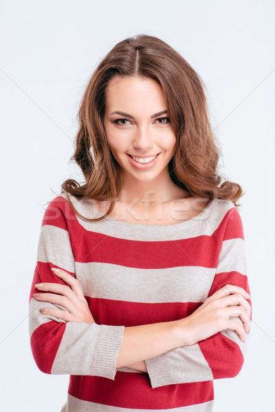Feliz cute mujer pie armas doblado Foto stock © deandrobot