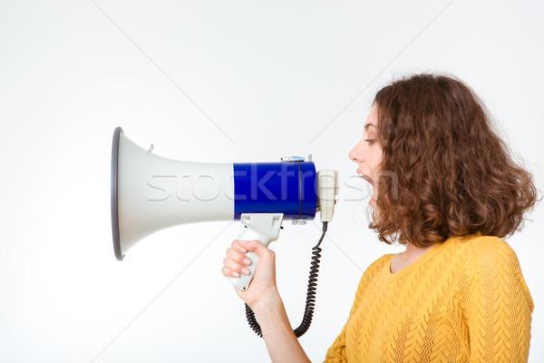 Mulher jovem gritando megafone vista lateral retrato isolado Foto stock © deandrobot