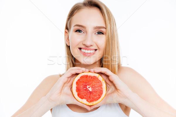 Kobieta plaster grejpfrut uśmiechnięty piękna kobieta Zdjęcia stock © deandrobot