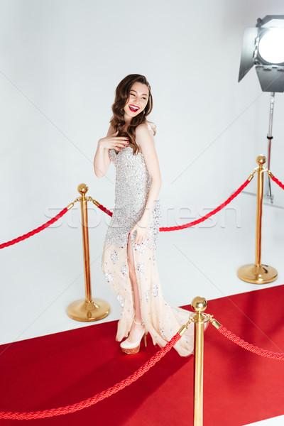 Nő pózol vörös szőnyeg nevet csinos nő divat Stock fotó © deandrobot