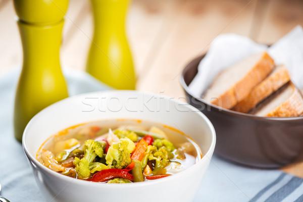 Branco tigela sopa de legumes pão sal pimenta Foto stock © deandrobot