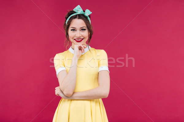Portrait of smiling beautiful young woman in yellow dress Stock photo © deandrobot
