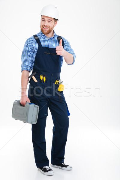 Glücklich Builder halten Werkzeugkasten Stock foto © deandrobot