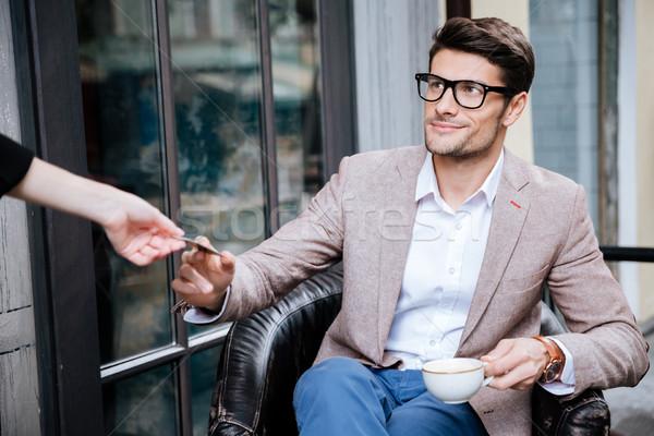 Mosolyog fiatalember fizet hitelkártya szabadtér kávézó Stock fotó © deandrobot