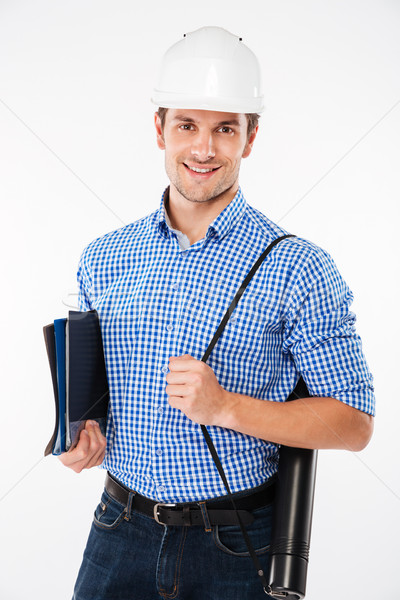Man building engineer in hard hat holding folders and blueprints Stock photo © deandrobot