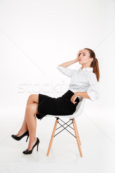 Jovem deprimido empresária dor de cabeça sessão cadeira Foto stock © deandrobot