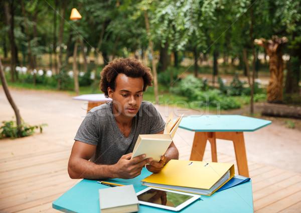Ciddi adam oturma eğitim park Afrika Stok fotoğraf © deandrobot