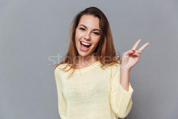 улыбаясь счастливым женщину победу знак Сток-фото © deandrobot