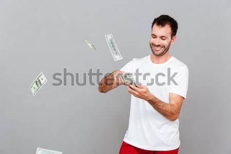 Portré mosolyog lezser férfi tart óvszer Stock fotó © deandrobot