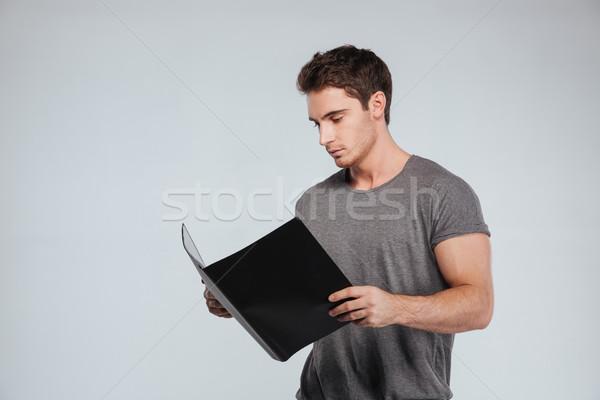 Portret zagęszczony przypadkowy człowiek folderze Zdjęcia stock © deandrobot