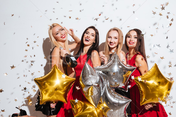 Femmes ballons confettis potable champagne fête Photo stock © deandrobot
