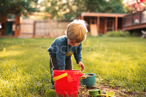 Young boy on playground Stock photo © deandrobot