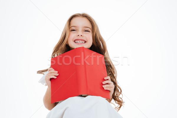 Feliz cute nina lectura rojo Foto stock © deandrobot
