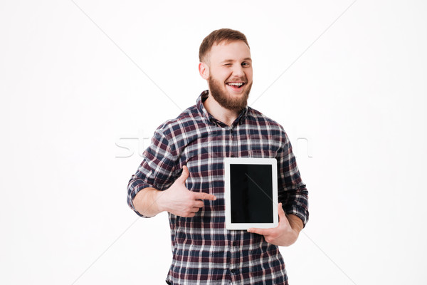 Stock photo: Smiling Man in shirt showing blank tablet computer screen