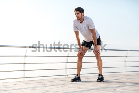 Sports man doing plank exercise with ball at the playground Stock photo © deandrobot