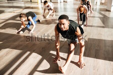 Stok fotoğraf: Kadın · oturma · bacaklar · grup · yoga