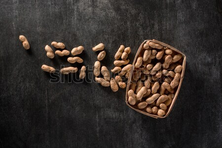 Dried peanuts on dark background Stock photo © deandrobot