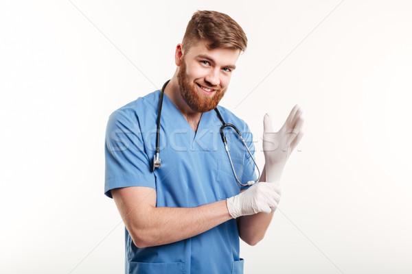 Portrait souriant accueillant médecin stérile gants Photo stock © deandrobot