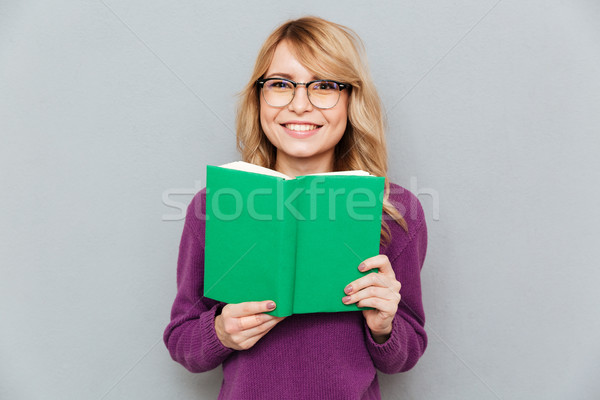 Woman with book smiling Stock photo © deandrobot