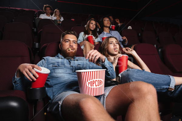 Impolite rude couple sitting in a cinema Stock photo © deandrobot