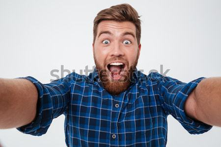 Close up picture of Shocked bearded man in checkered shirt Stock photo © deandrobot