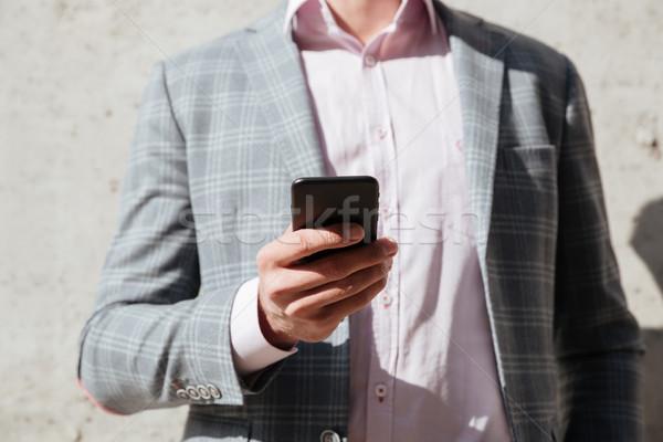 Człowiek kurtka telefonu komórkowego obraz ściany Zdjęcia stock © deandrobot