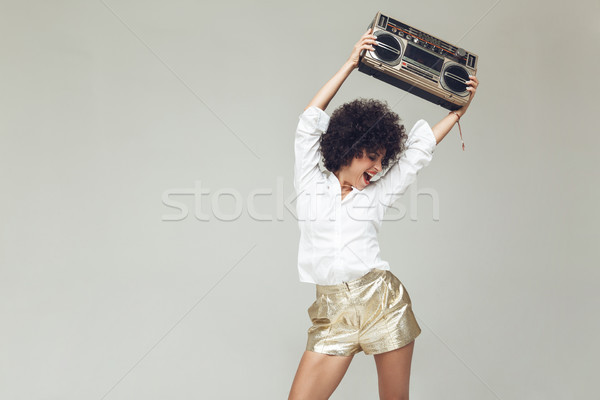 Retro woman dressed in shirt standing and posing Stock photo © deandrobot