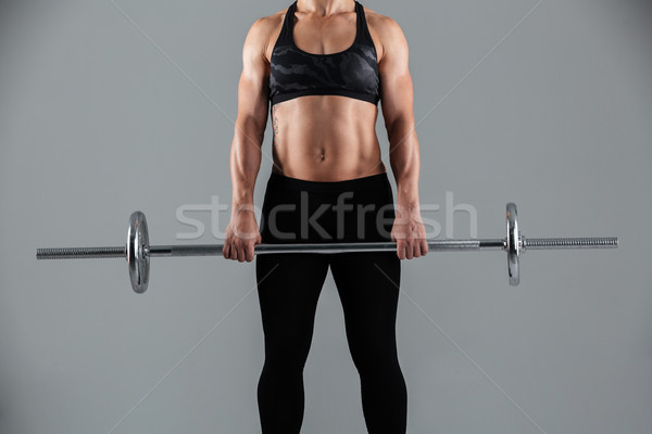 Cropped image of a strong muscular adult sportswoman Stock photo © deandrobot