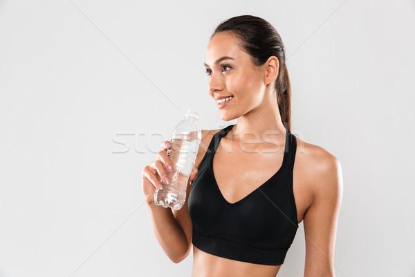 Boldog fiatal sportok nő pózol izolált Stock fotó © deandrobot