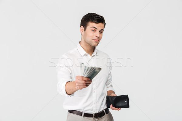 портрет успешный улыбаясь человека бумажник Сток-фото © deandrobot