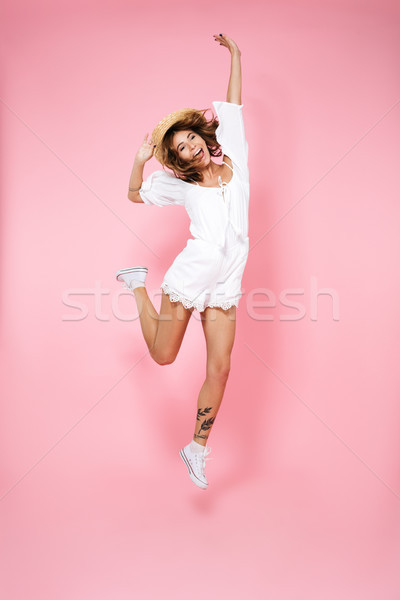 Full length portrait of an excited brown haired girl Stock photo © deandrobot