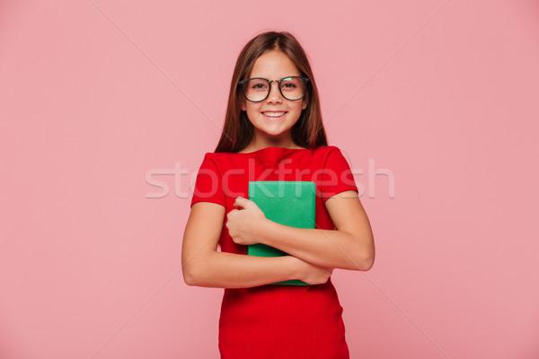 Wesoły dziewczyna nerd książek patrząc Zdjęcia stock © deandrobot