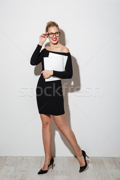 Full length image of Smiling woman in dress and eyeglasses Stock photo © deandrobot