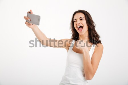 Studio portrait of beautiful woman smiling with white teeth and  Stock photo © deandrobot