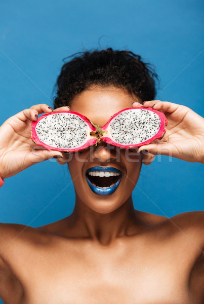 Vertical portrait of cheerful african american woman fooling aro Stock photo © deandrobot