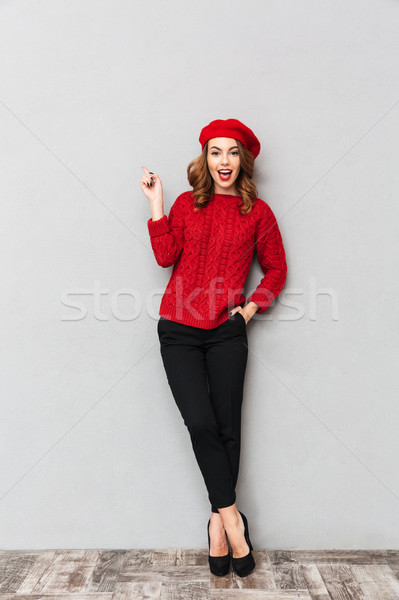 Full length portrait of a pretty woman Stock photo © deandrobot
