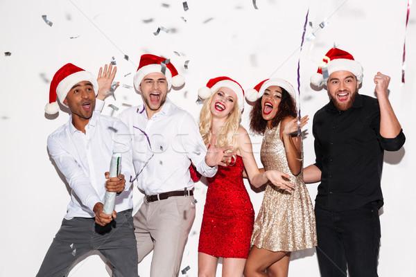 счастливым молодые друзей Рождества Сток-фото © deandrobot