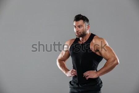 Portrait of a muscular serious male bodybuilder Stock photo © deandrobot