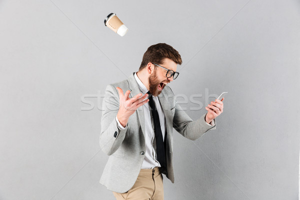 Portrait of a mad businessman dressed in suit Stock photo © deandrobot