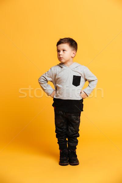 Koncentrált kicsi fiú gyermek fotó áll Stock fotó © deandrobot